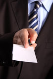 Businessman handing a blank business card Royalty Free Stock Image