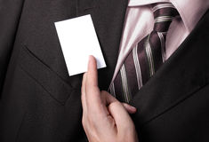 Businessman handing a blank business card Royalty Free Stock Photos