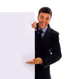 Businessman handing a blank business card over wh. Business man handing a blank business card over white background stock photos