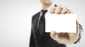 Businessman handing a blank business card Stock Photo