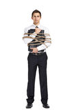 Businessman handing briefcase bound with the cord Royalty Free Stock Photo