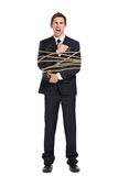 Businessman handing briefcase bound with the rope Stock Photo