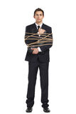 Businessman handing briefcase bound with the string. Full-length portrait of businessman handing briefcase who tied with the string, isolated on white. Concept Stock Photography