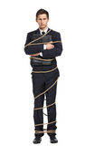 Businessman handing briefcase tied with the rope. Full-length portrait of businessman handing briefcase who tied with the rope, isolated on white. Concept of Stock Image