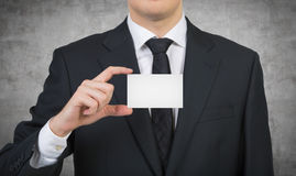 Businessman handing a business card Royalty Free Stock Photography