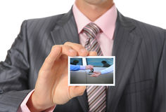 Businessman handing a card Stock Image