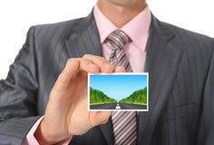 Businessman handing a card Stock Photo