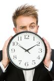 Businessman handing clock Royalty Free Stock Photography