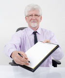 Businessman handing contract Stock Image