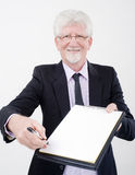 Businessman handing contract. To sign Royalty Free Stock Images