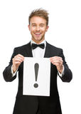 Businessman handing exclamatory mark. Half-length portrait of businessman handing exclamatory mark, isolated on white. Concept of problem and solution Stock Photo