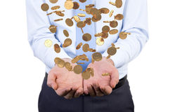 Businessman handing falling coins Royalty Free Stock Images
