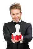 Businessman handing gift box stock images