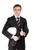 Businessman handing helmet in hands Stock Photo