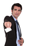 Businessman handing his business card. Royalty Free Stock Image