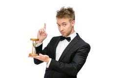 Businessman handing hourglass. Half-length portrait of businessman handing hourglass and attention gesturing, isolated on white Royalty Free Stock Images