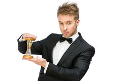 Businessman handing hourglass. Half-length portrait of businessman handing hourglass, isolated on white Royalty Free Stock Photography