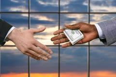 Businessman handing money near window. Stock Photography