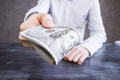 Businessman handing money Royalty Free Stock Images
