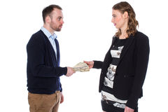 Businessman handing money to woman Stock Photography