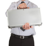 Businessman handing over briefcase Stock Photos