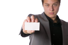 Businessman handing over a business card Stock Photo