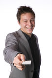 Businessman handing over a business card Stock Photography