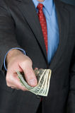 Businessman handing over cash Stock Photography