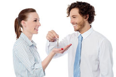 Businessman handing over the key Royalty Free Stock Image