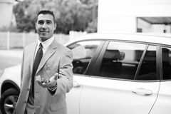 Businessman handing over the keys Royalty Free Stock Photo