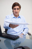 Businessman handing over paperwork Stock Photo