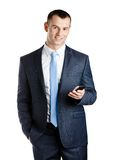 Businessman handing phone Stock Image
