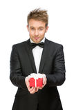 Businessman handing present box Royalty Free Stock Images