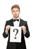 Businessman handing question mark Royalty Free Stock Photo