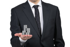Businessman handing silver coins Royalty Free Stock Photography