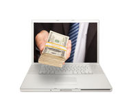 Businessman Handing Stack of Money Thru Screen Stock Photo
