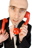 Businessman handling calls Royalty Free Stock Images