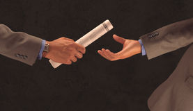 Businessman handoff. With business newspaper as baton Stock Image