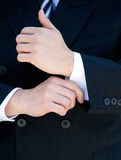 Businessman hands adjusting shirt cuff Royalty Free Stock Photo