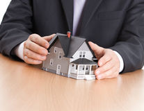 Businessman hands around architectural model royalty free stock photos