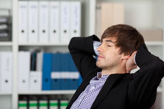 Businessman With Hands Behind Head And Closed Eyes Royalty Free Stock Photo