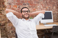 Businessman with hands behind head in office Royalty Free Stock Photos