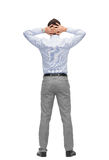 Businessman with hands behind his head from back Stock Photo
