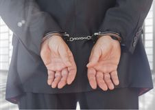 Businessman with hands bonded in hand cuffs Royalty Free Stock Photo