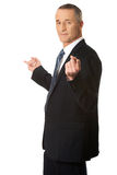 Businessman with hands on both sides Stock Image