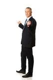 Businessman with hands on both sides Royalty Free Stock Images