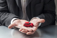 Businessman hands caring for automotive systems Stock Images