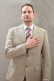 Businessman with hands on chest Royalty Free Stock Images