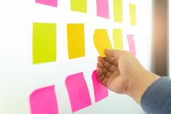 Businessman hands are choosing to empty sticky notes stock photo