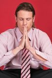 Businessman with hands clasped Stock Photos